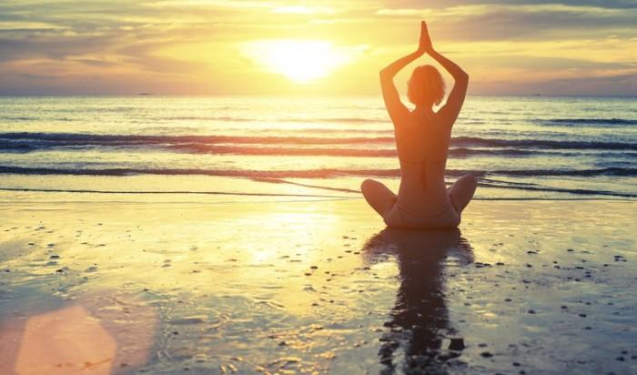 bigstock-Silhouette-of-yoga-woman-medit-80797538-848x500