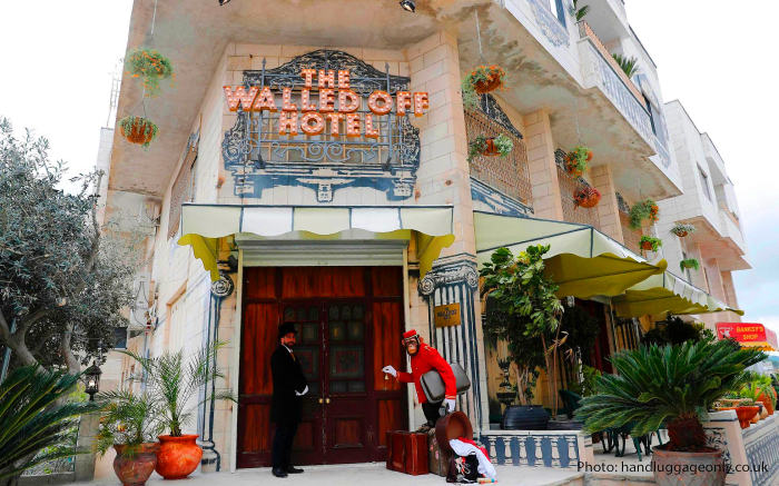 "The Walled Off Hotel: Banksy Opens Dystopian Tourist Attraction In Bethlehem With The ""Worst View In The World"""